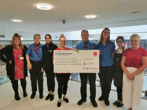 The Mall team present the team from East Lancashire Hospice with their cheque