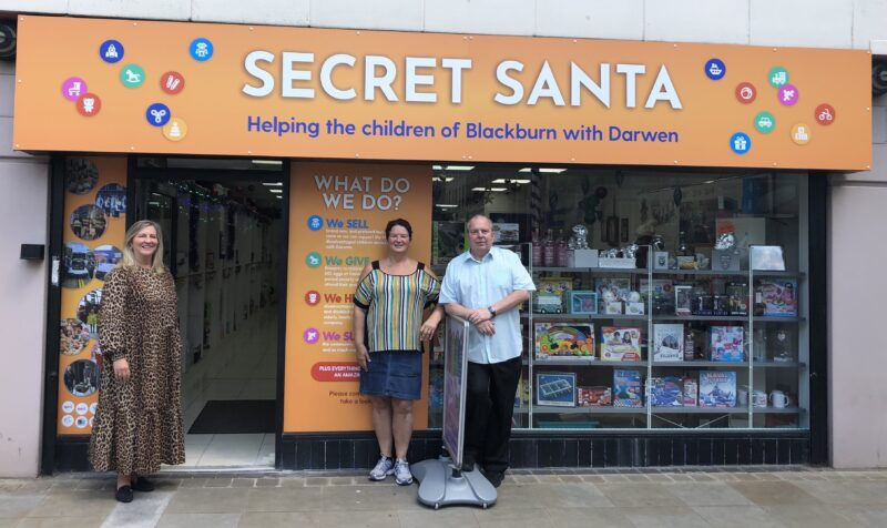 Loraine Jones, General Manager at The Mall Blackburn with Karen and Phil Boulding from Secret Santa.