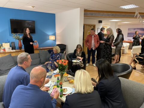 Paint Thw Town Orange event with visitors enjoying buffet lunch and raffle